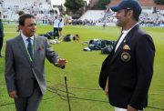 Former Indian cricketer Sunil Gavaskar speaks with MS Dhoni