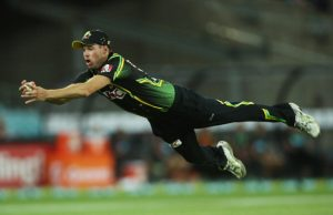 Ben Laughlin of Australia dives to take a catch