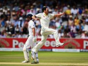 Mitchell Johnson of Australia celebrates after taking the wicket of Alastair Cook