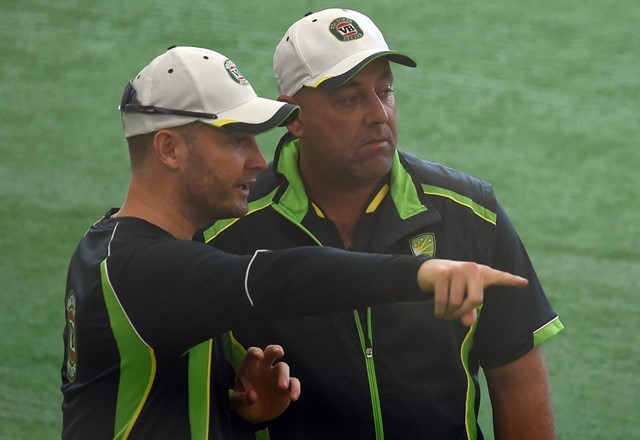 Australian captain Michael Clarke (L) speaks with coach Darren Lehmann during an indoor training session ahead of their 2015 Cricket World Cup match against Bangladesh at the Bupa National Cricket Centre in Brisbane on February 20, 2015.   (Photo by INDRANIL MUKHERJEE/AFP/Getty Images)