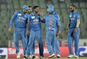 Bhuvneshwar Kumar celebrates with teammates India