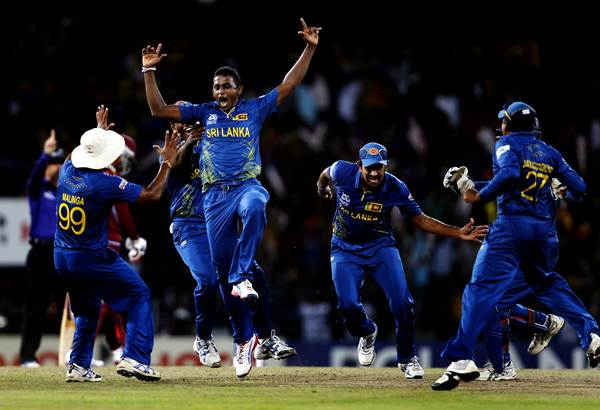 COLOMBO, SRI LANKA - OCTOBER 7: Sri Lankan player Ajantha Mendis celebrates the dismissal of West Indies player Chris Gayle during the ICC World T20 Final between Sri Lanka and West Indies at R. Premadasa Stadium on October 7, 2012 in Colombo, Sri Lanka. (Photo by Ajay Aggarwal/Hindustan Times via Getty Images)