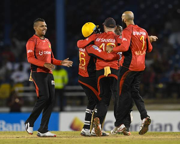 Port of Spain , Trinidad And Tobago - 29 June 2016; Sunil Narine, left, of Trinbago Knight Riders celebrates with teammates the dismissal of Johnson Charles of St Lucia Zouks during Match 1 of the Hero Caribbean Premier League between Trinbago Knight Riders and St Lucia Zouks at the Queen's Park Oval in Port of Spain, Trinidad. (Photo By Randy Brooks/Sportsfile via Getty Images)
