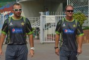 Pakistani cricket team batting coach Grant Flower (R) arrives with fielding coach Grant Luden for a news conference in Lahore on July 18, 2014. Grant Flower stressed improving Pakistan's faltering batsmen will be a