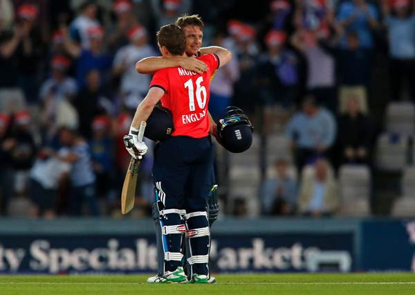 England's Captain Eoin Morgan (L) and England's Jos Buttler embrace after England win the game. (Photo by IAN KINGTON/AFP/Getty Images)