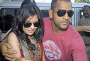 Indian cricket captain Mahendra Singh Dhoni and his wife Sakshi arrive at the airport in Kolkata on July 8, 2010. Dhoni and Sakshi married in a hush-hush ceremony on July 4 at a farmhouse near Dehradun. AFP PHOTO/STR (Photo credit should read STRDEL/AFP/Getty Images)