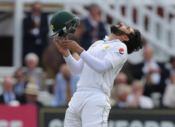 Pakistan's Misbah-Ul-Haq celebrates his century on the first day of the first Test cricket match between England and Pakistan at Lord's cricket ground in London, on July 14, 2016. / AFP / Lee MILLS / RESTRICTED TO EDITORIAL USE. NO ASSOCIATION WITH DIRECT COMPETITOR OF SPONSOR, PARTNER, OR SUPPLIER OF THE ECB (Photo credit should read LEE MILLS/AFP/Getty Images)