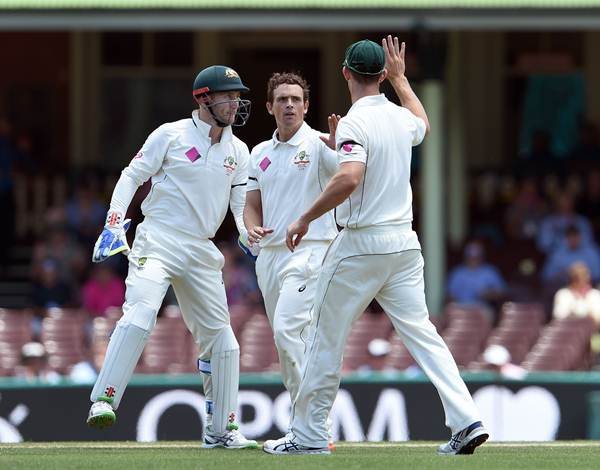 Australian spinner Stephen O'Keefe (C) is congratulated by teammates Mitch Marsh (R) and Peter Nevill (L) after dismissing West Indies batsman Denesh Ramdin on the final day of the third cricket Test match in Sydney on January 7, 2016. AFP PHOTO / William WEST --IMAGE RESTRICTED TO EDITORIAL USE - NO COMMERCIAL USE-- / AFP / WILLIAM WEST (Photo credit should read WILLIAM WEST/AFP/Getty Images)