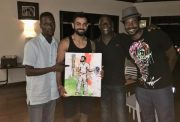Virat Kohli with the painting he received from Mali Richards, son of Sir Viv Richards
