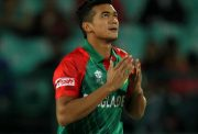 Bangladesh's Taskin Ahmed reacts after taking the wicket of Oman's Zeeshan Maqsood during the qualifying match for the World T20 cricket tournament between Bangladesh and Oman at The Himachal Pradesh Cricket Association Stadium in Dharamsala on March 13, 2016. / AFP / STR (Photo credit should read STR/AFP/Getty Images)
