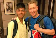 Michael Clarke with nepal's teenage leg-spinner Sandeep Lamichhane