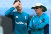 Jos Buttler(L) and head coach Trevor Bayliss