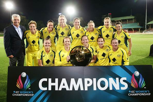 poses with the ICC Women's Championship trophy alongside ICC ...