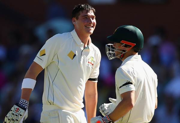 ADELAIDE, AUSTRALIA - NOVEMBER 27: Matthew Renshaw of Australia talks to David Warner of Australia during day four of the Third Test match between Australia and South Africa at Adelaide Oval on November 27, 2016 in Adelaide, Australia. (Photo by Cameron Spencer/Getty Images)