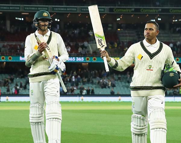 Usman Khawaja of Australia is applauded off the field at the end of play during day two. (Photo by Cameron Spencer/Getty Images)