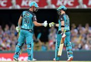 Brendon McCullum of the Heat celebrates with team mate Chris Lynn