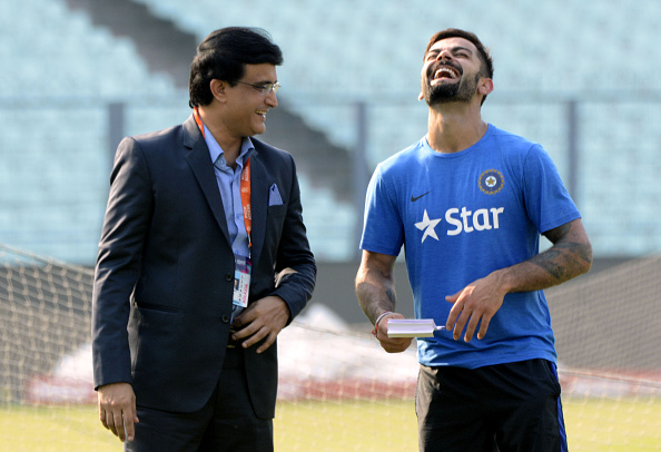 India's Virat Kohli(R)and former captain Saurav Ganguly share a light moment during a training session at The Eden Gardens Cricket Stadium in Kolkata on March 18, 2016. India will play Pakistan in their latest match of the ongoing World T20 tournament on March 19. / AFP / STR (Photo credit should read STR/AFP/Getty Images)