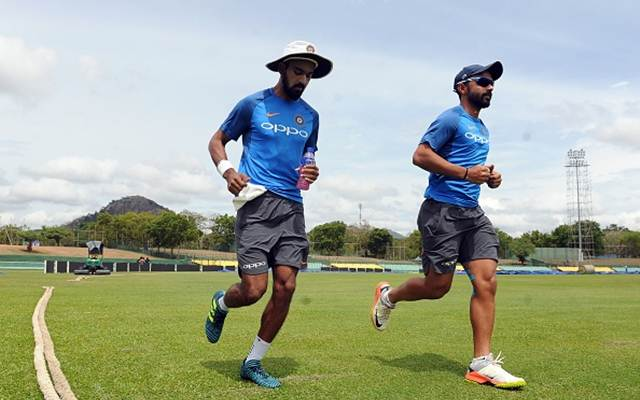 Ajinkya Rahane (R) and teammate Lokesh Rahul
