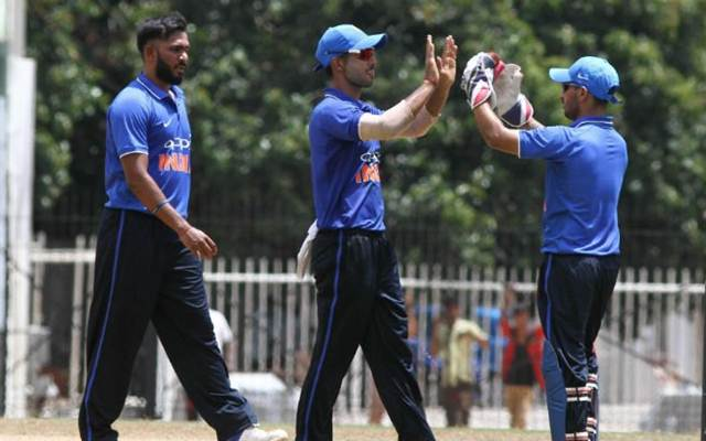 Indian Board President's XI players celebrate a fall of a wicket in the warm-up game against Australia