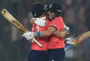 England's Jos Buttler (L) and Joe Root