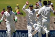 Matthew Hayden of Australia congratulates Mitchell Johnson