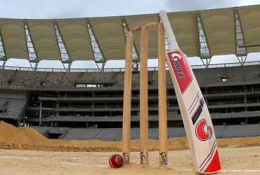 Cricket stumps, bat and ball