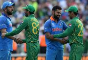 Virat Kohli and Yuvraj Singh of India shakes hands with Shadab Khan and Junaid Khan of Pakistan