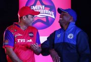 Virender Sehwag shares a joke with Brian Lara