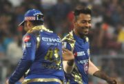 Mumbai Indians celebrate fall of a wicket