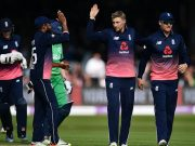 Joe Root of England (2R) celebrates taking the wicket of Niall OBrien of Ireland