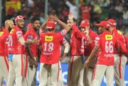 Kings XI Punjab players celebrate fall of a wicket