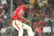Kings XI Punjab player Sandeep Sharma celebrates fall of Virat Kohli's wicket IPL