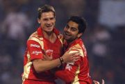 Dale Steyn of RC Bangalore celebrates with team mate Virat Kohli