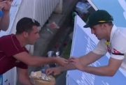 A fan offers food to Mitchell Marsh