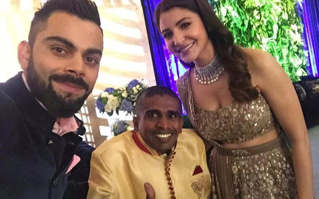 Virat Kohli & Anushka Sharma with the Sri Lankan fan Gayan Senanayake. (Twitter)