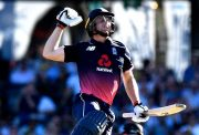 Jos Buttler of England celebrates scoring a century