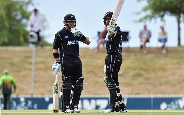 Martin Guptill of New Zealand celebrates his half century
