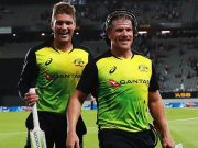 Alex Carey of Australia and Aaron Finch of Australia walk off after beating New Zealand