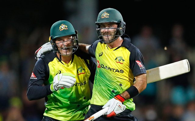 Glenn Maxwell of Australia celebrates his century with Alex Carey