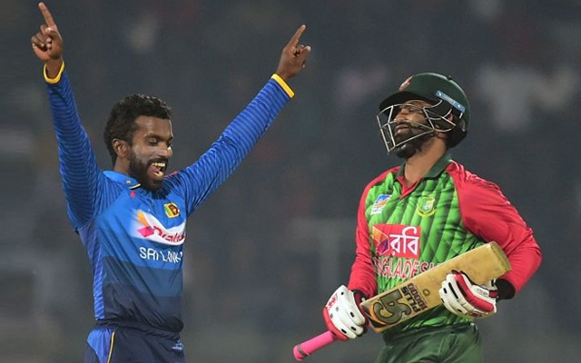 Sri Lanka cricketer Amila Aponso celebrates after the dismissal of the Bangladesh cricketer Tamim Iqbal