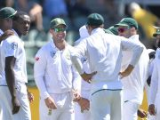 Kagiso Rabada and teammates of South Africa celebrate the wicket of David Warner