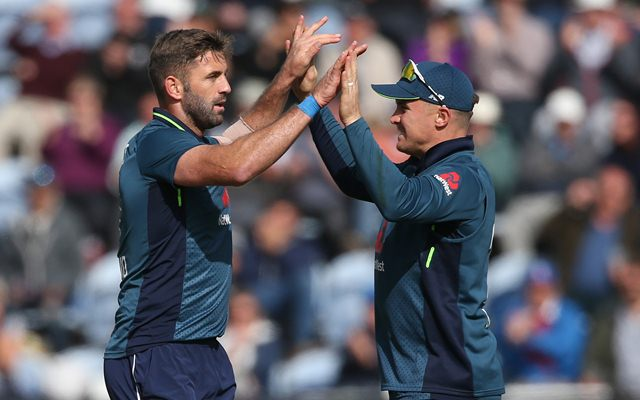 Liam Plunkett (L) and Jason Roy of England celebrate the wicket of Marcus Stoinis