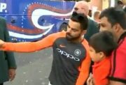 Virat Kohli clicks a selfie with a fan