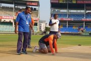 MS Dhoni inspecting the pitch