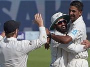 New Zealand spinner Ish Sodhi celebrates with teammate Ajaz Patel