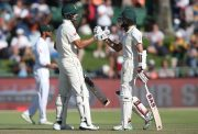 Aiden Markram of South Africa is congratulated by Hashim Amla