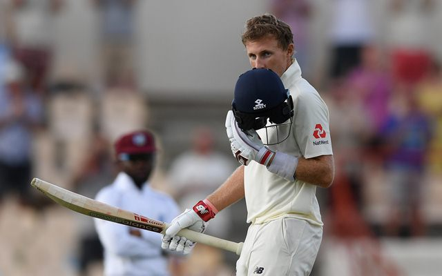 Joe Root celebrates reaching his 100