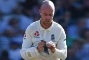 Jack Leach cleainiing his glass