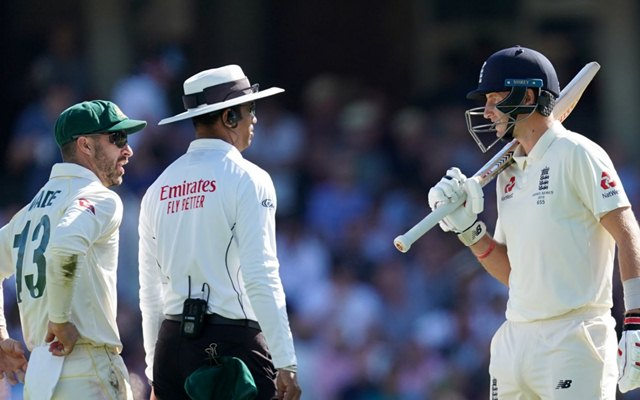 Joe Root speaks to Matthew Wade
