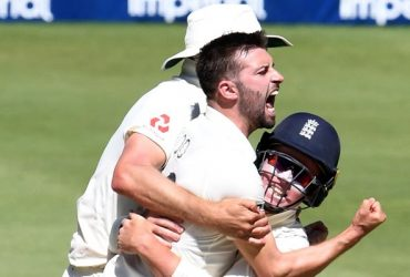 Mark Wood and Ollie Pope of England celebrate